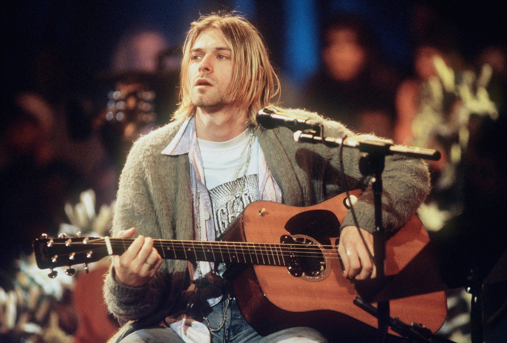 Image may contain: Musical Instrument, Guitar, Leisure Activities, Human, Person, Kurt Cobain, Musician, and Performer